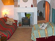 Living room with wood burning stove Rural accommodation with two bedrooms, Comares, Malaga